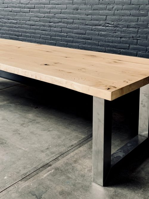 Unique heavy oak table with stainless steel base.