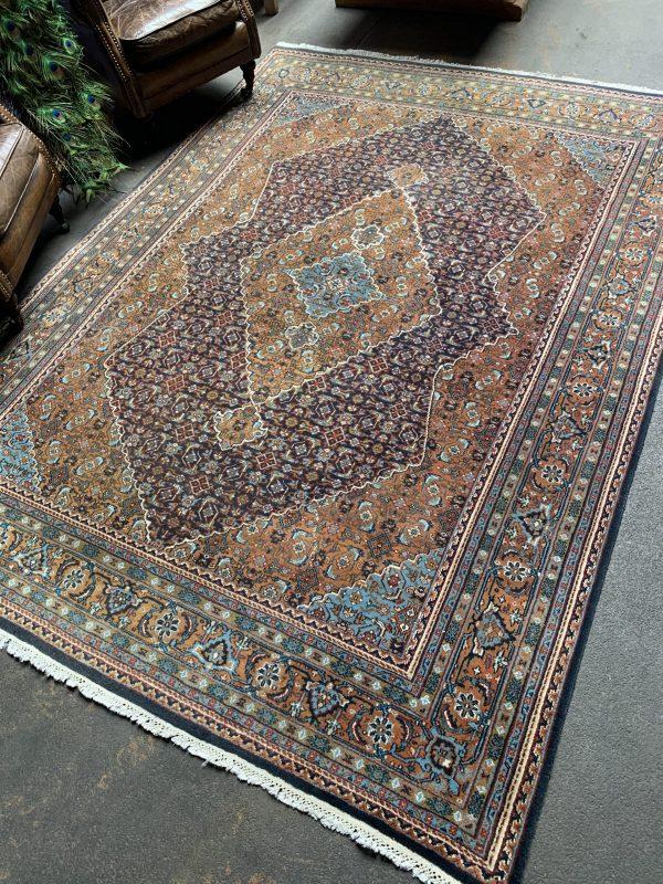 Hand-knotted vintage woolen Bidjar Persian carpet.