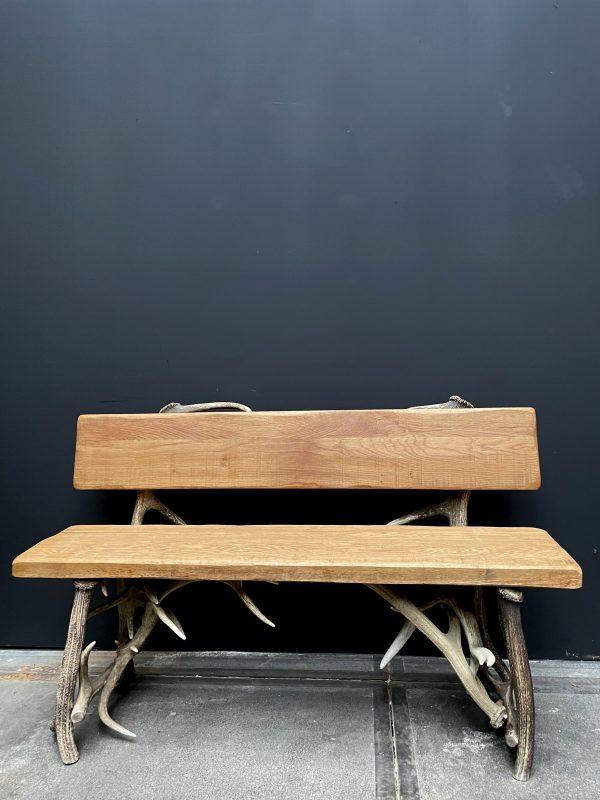 Robuuste bank van gewei met eikenhout
