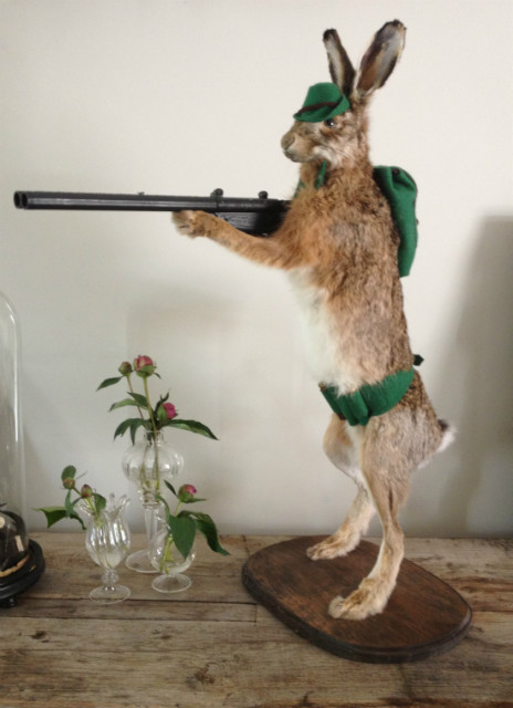 FM 210, Mounted hare with gun. Hunting hare