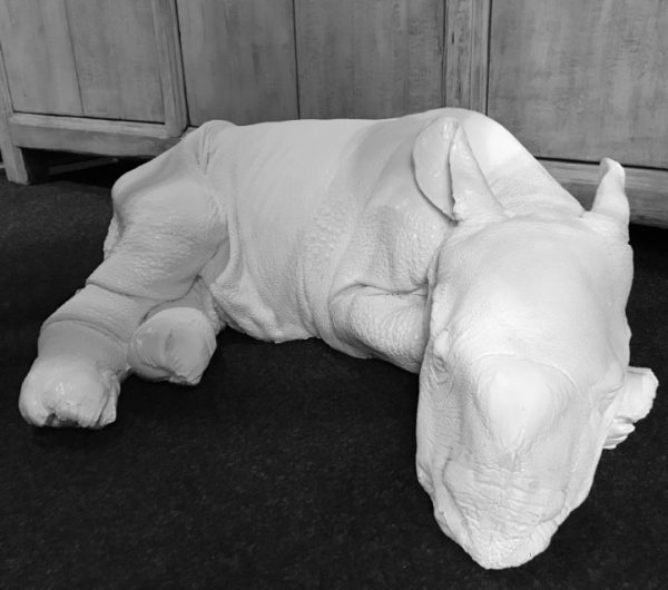 Lifelike replica of a rhinoceros calf